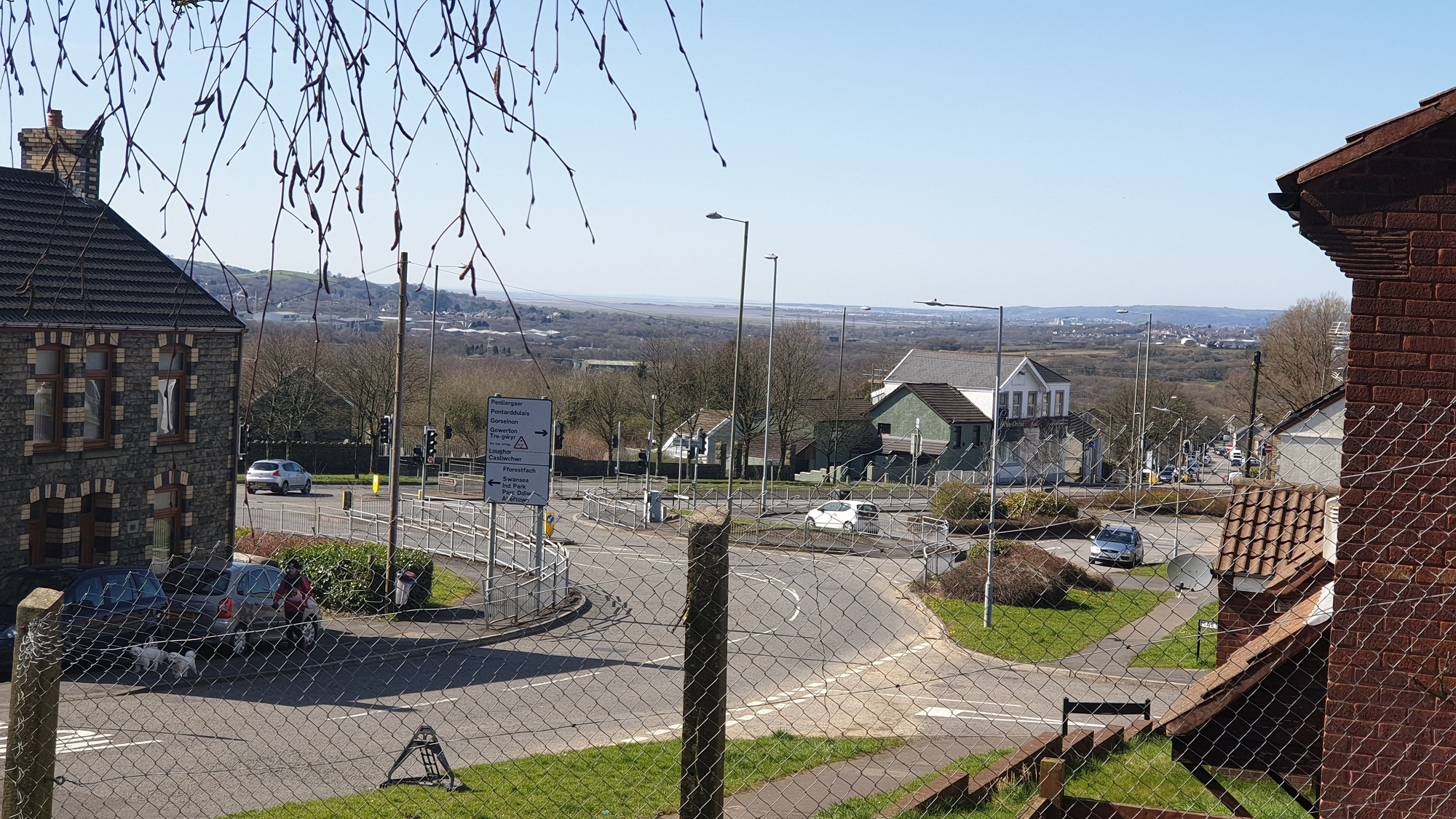 The town stretches into the distance beyond the fence the photographer stands behind