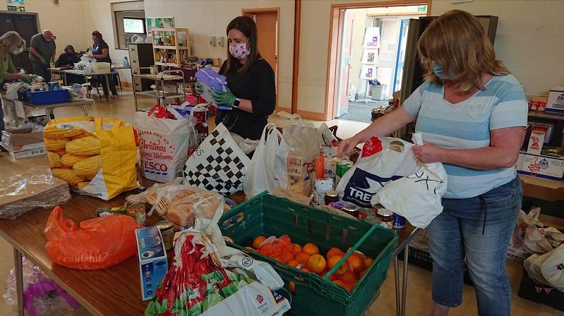 Volunteers work at the food bank sorting food