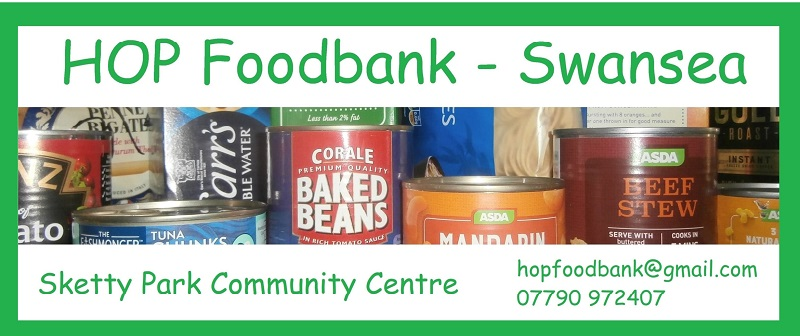 The promotional poster for the food bank is shown with images of tins and food