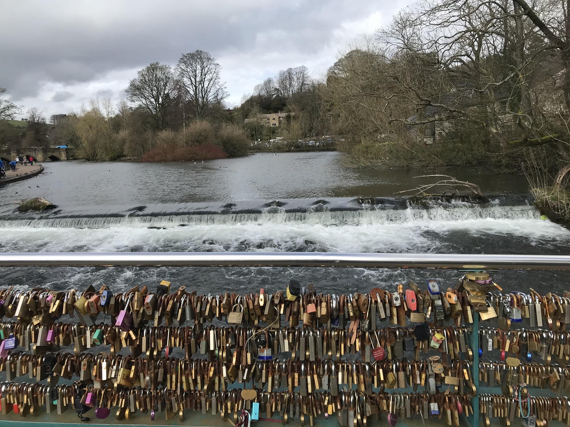 Colourful padlocks span a bridge