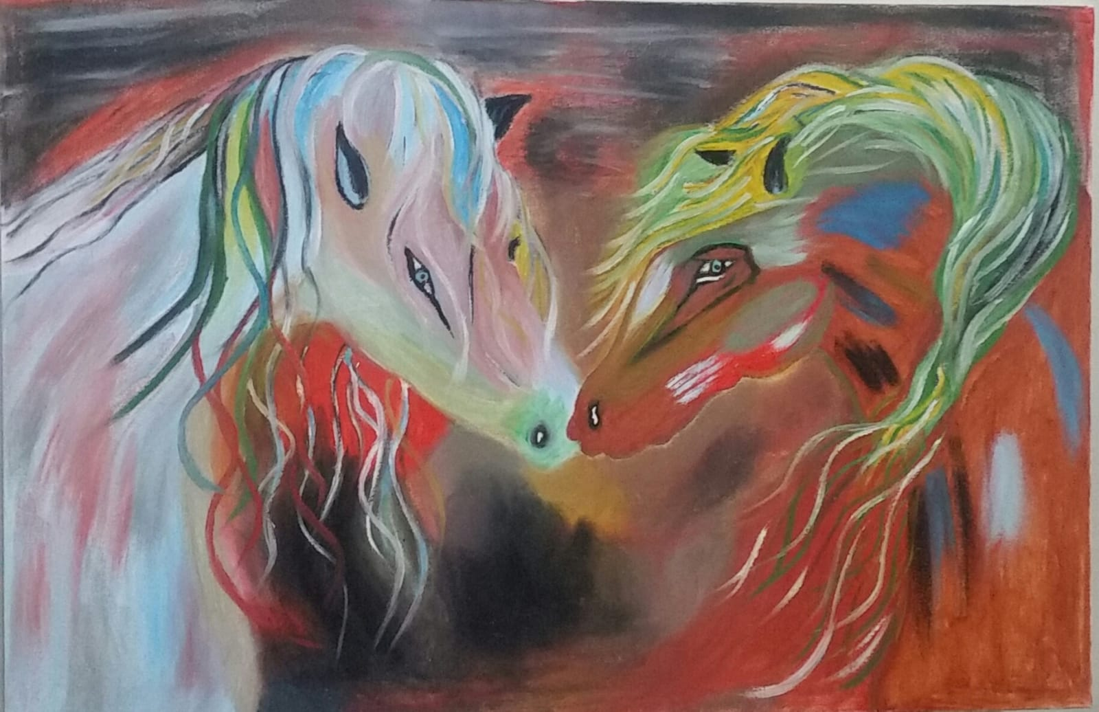 Two colourful horses with long manes rest their heads towards each other