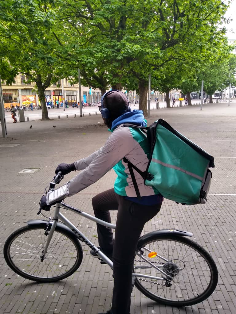 An undocumented migrant student living in the Netherlands describes his experience working as a freelance rider for Deliveroo during lockdown